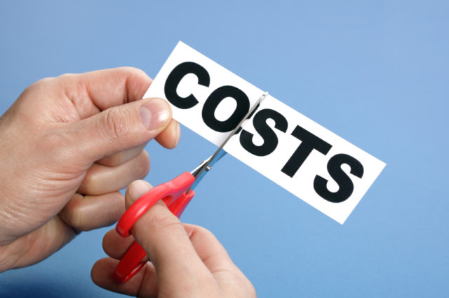 Scissors cutting the word costs concept for recession or credit crisis